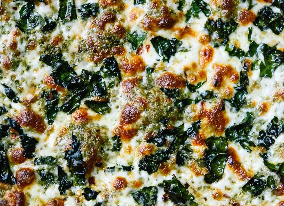 Kale pesto on pizza! cookieandkate.com