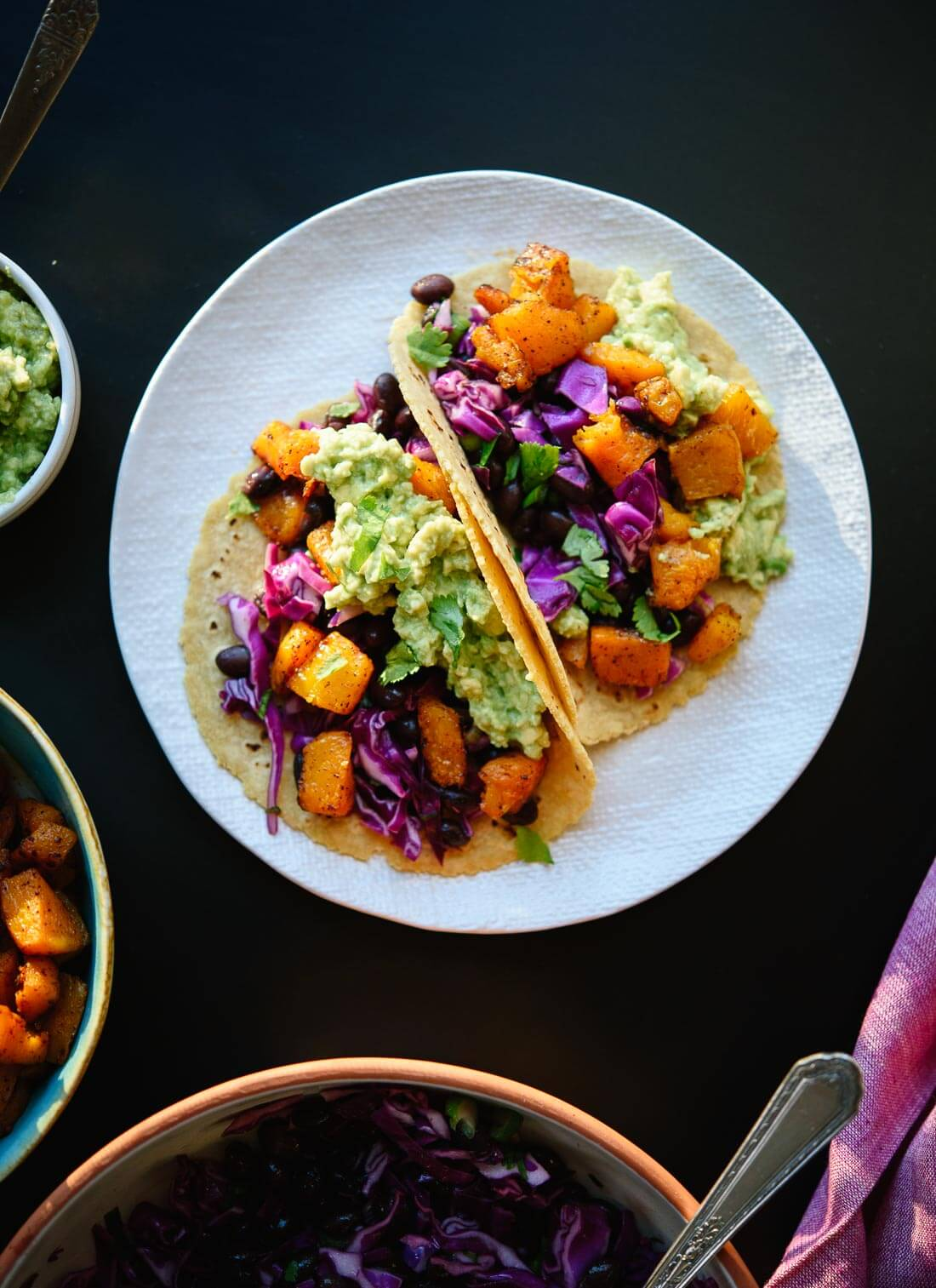 Roasted butternut squash tacos with guacamole! Vegan and gluten free. cookieandkate.com