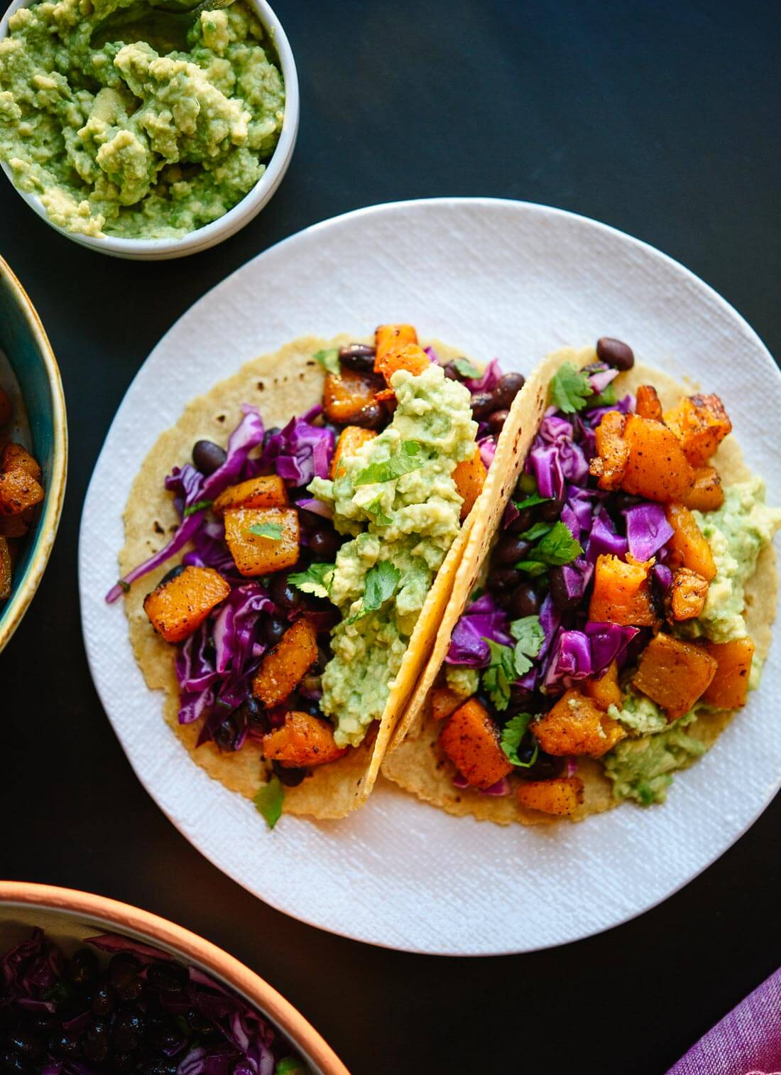 These roasted butternut squash tacos with slaw are bursting with flavor and so good for you, too. cookieandkate.com