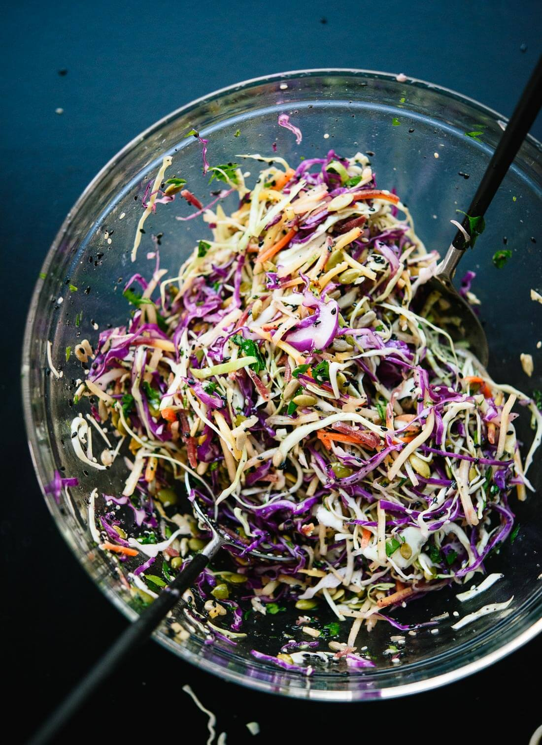 This healthy slaw recipe tastes amazing! It's made with a simple lemon dressing and features toasted sunflower and pumpkin seeds. Gluten free and vegan. - cookieandkate.com