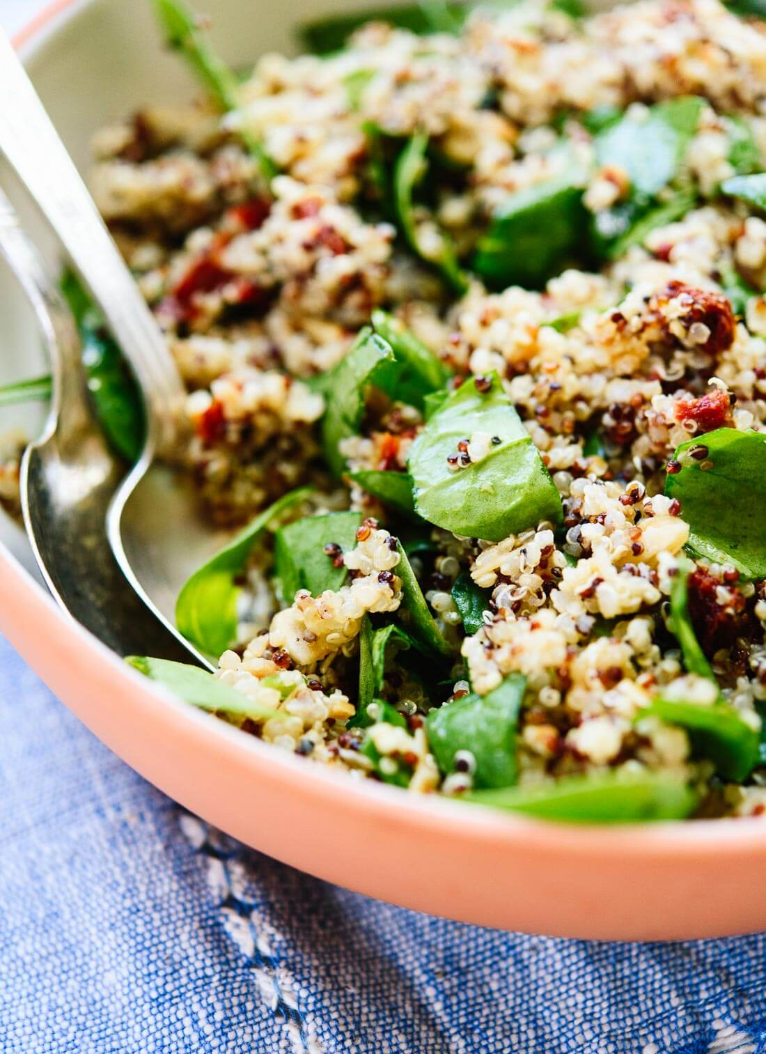 Simple quinoa salad with spinach, sun-dried tomatoes, toasted almonds and a zippy lemon dressing! cookieandkate.com
