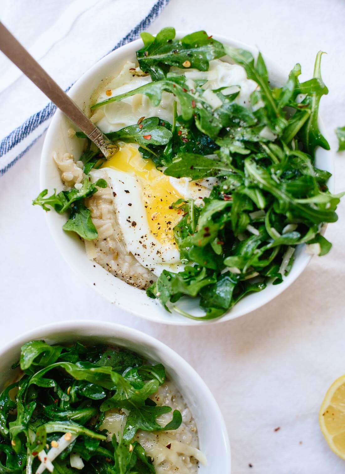 Savory steel cut oatmeal with arugula and a fried egg on top - cookieandkate.com