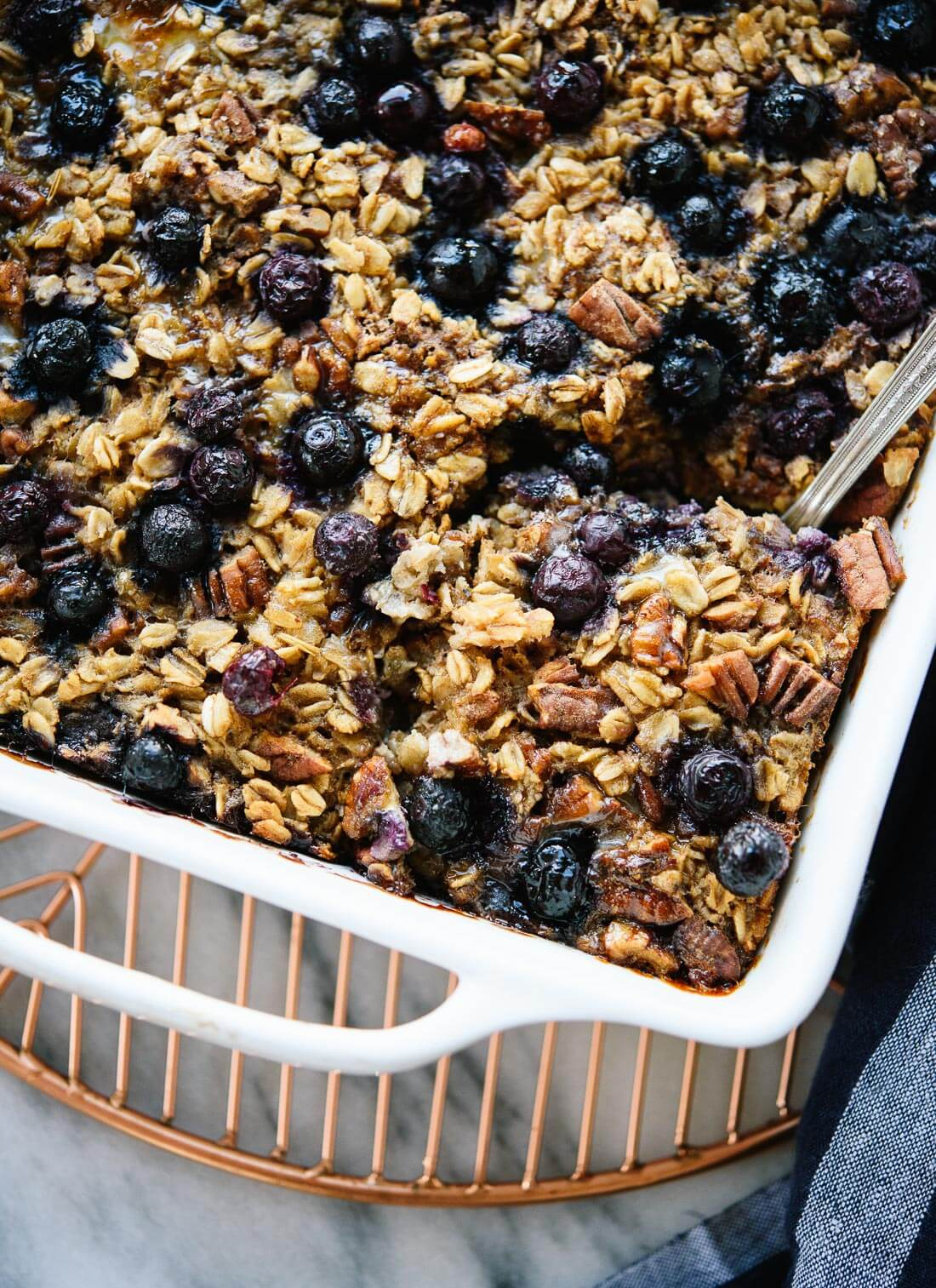 Amazing blueberry baked oatmeal, so good with yogurt in the mornings! - cookieandkate.com
