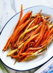 My new favorite side dish, roasted carrots with honey butter - recipe at cookieandkate.com