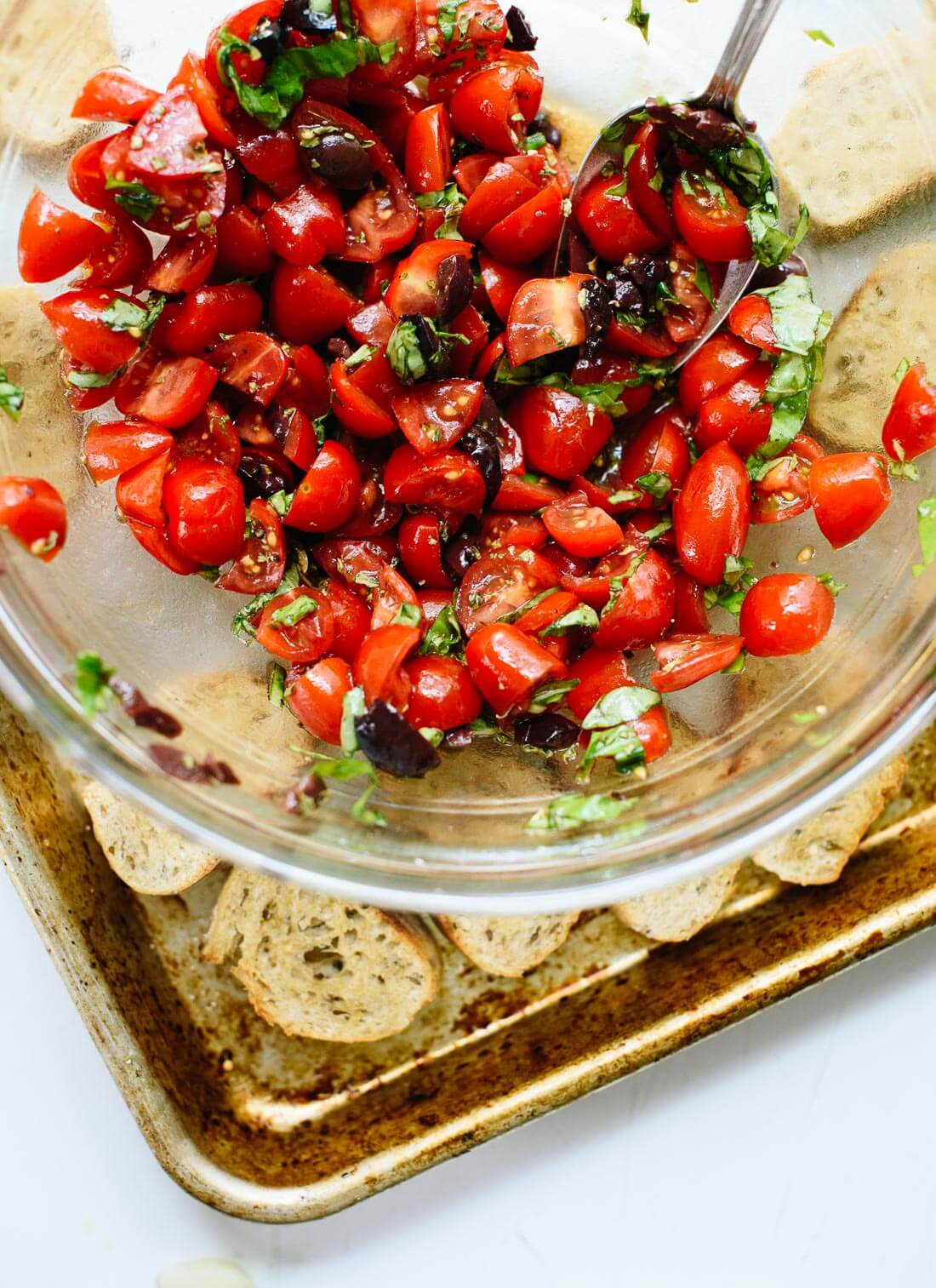 This cherry tomato crostini is a perfect appetizer, and it's ready in 15 minutes! cookieandkate.com