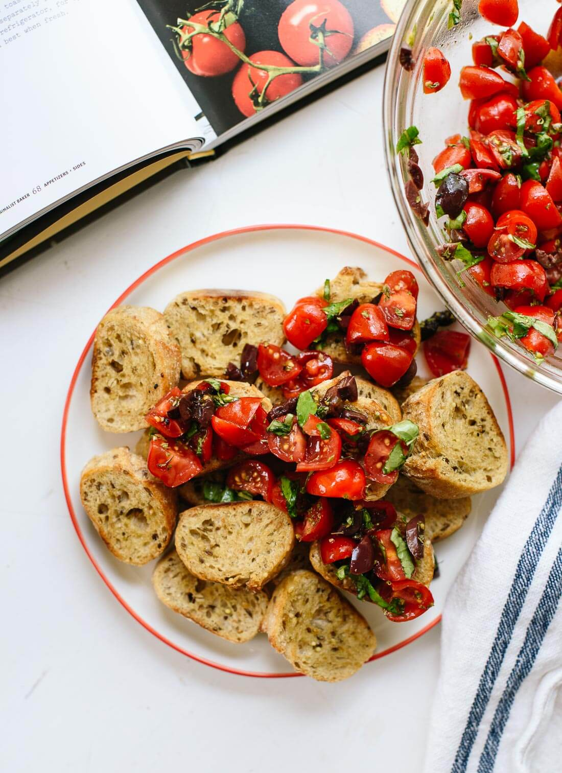 This easy bruschetta features cherry tomatoes, basil and balsamic vinegar. Delicious! cookieandkate.com