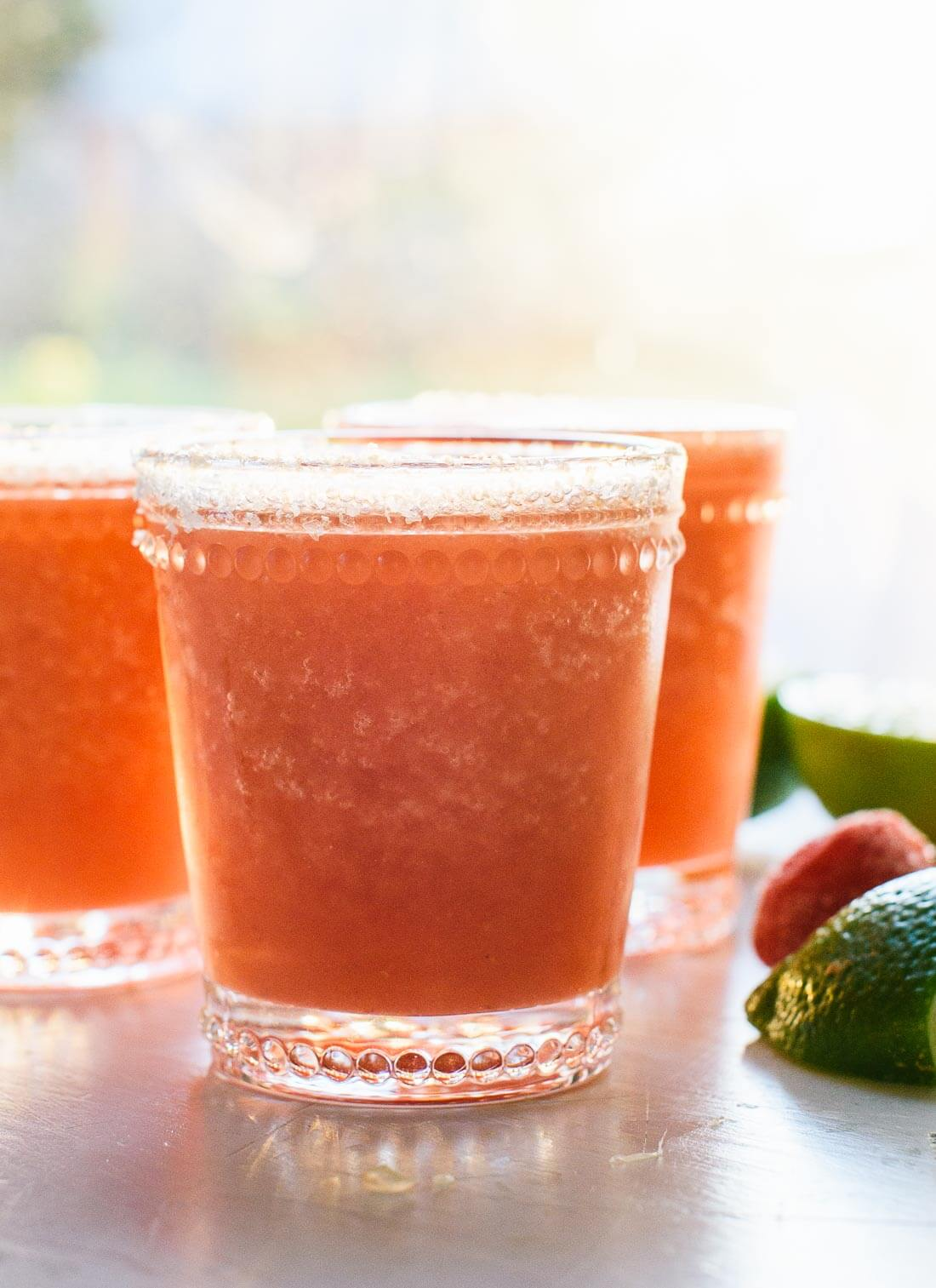 Super refreshing frozen strawberry margaritas, made with all-natural ingredients! Ready in 10 minutes. cookieandkate.com