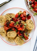 This simple Greek bruschetta recipe is ready in 15 minutes! Recipe from Minimalist Baker's new cookbook, Everyday Cooking. cookieandkate.com