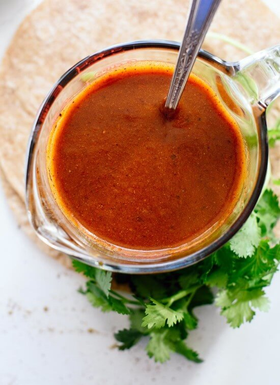 Easy homemade enchilada sauce is so easy! This sauce tastes so good, you'll never go back to the store-bought kind. Perfect for your other Mexican recipes, too! cookieandkate.com