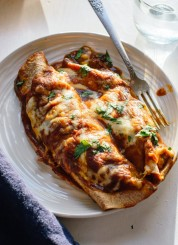 The best vegetarian enchiladas, stuffed with broccoli, bell pepper, spinach and black beans! cookieandkate.com