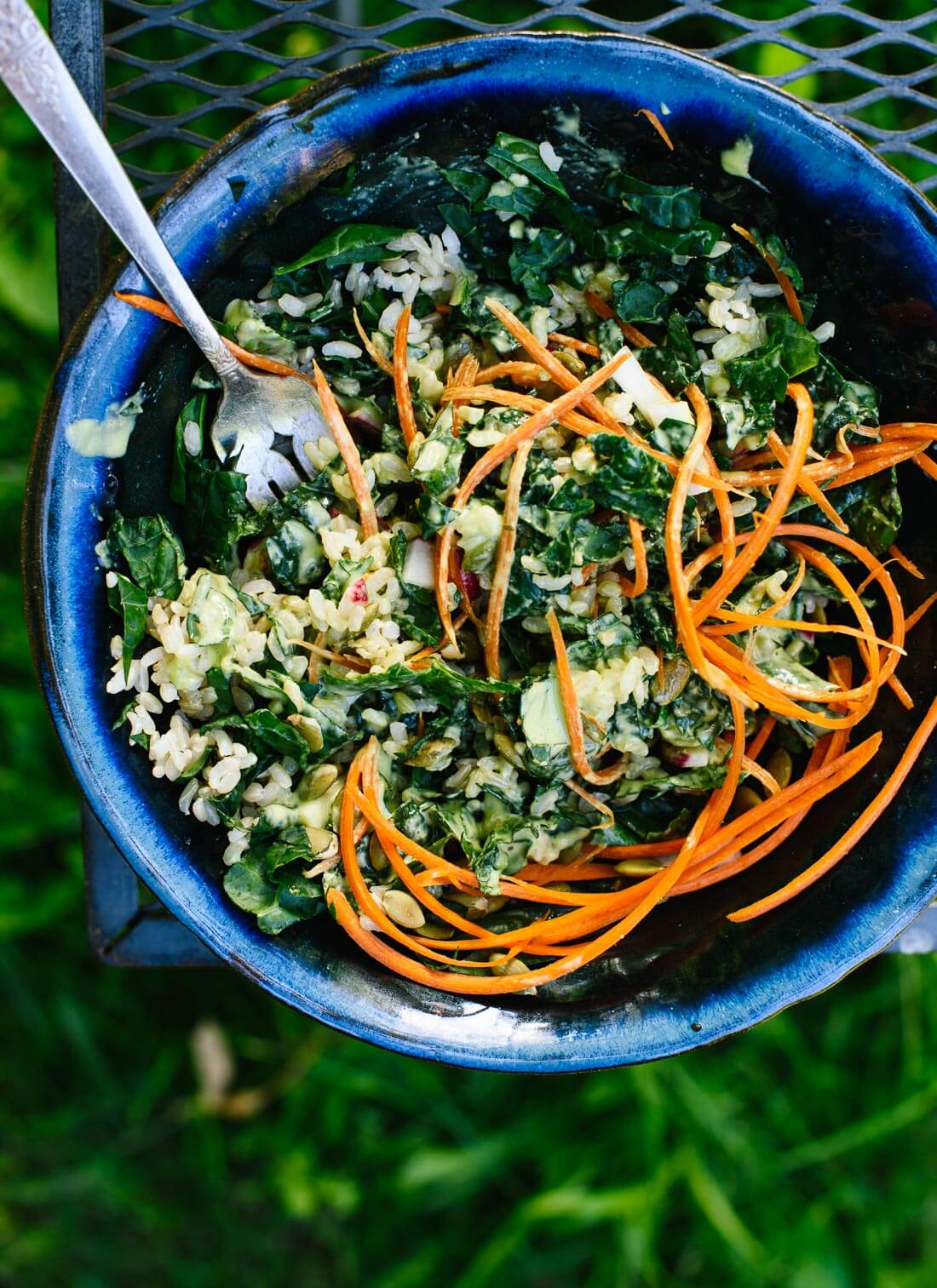 Super versatile kale salad recipe with an amazing green tahini salad dressing - cookieandkate.com