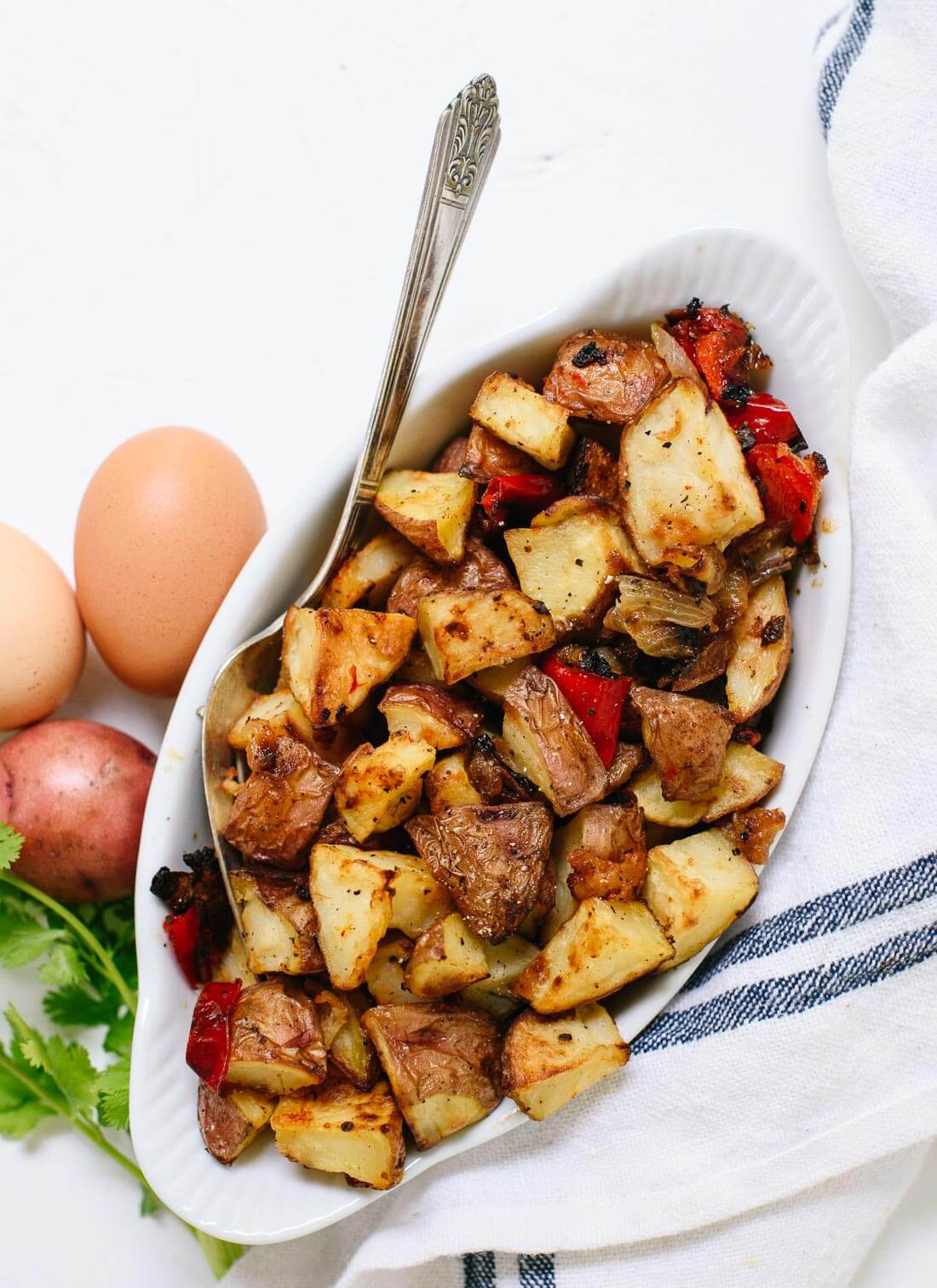 Amazing crispy roasted breakfast potatoes (also called home fries!). They are absolutely delicious, easy to make, and healthier than fried potatoes! #breakfast