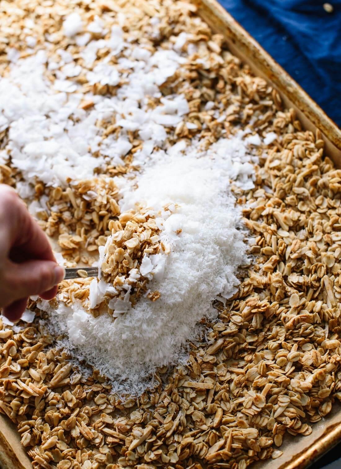 Stirring coconut into coconut granola - cookieandkate.com