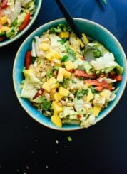 Fresh Thai green salad with sweet mango, bell pepper and a spicy peanut dressing! cookieandkate.com