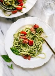 Delicious zucchini noodles (zoodles) with pesto and tomatoes - cookieandkate.com
