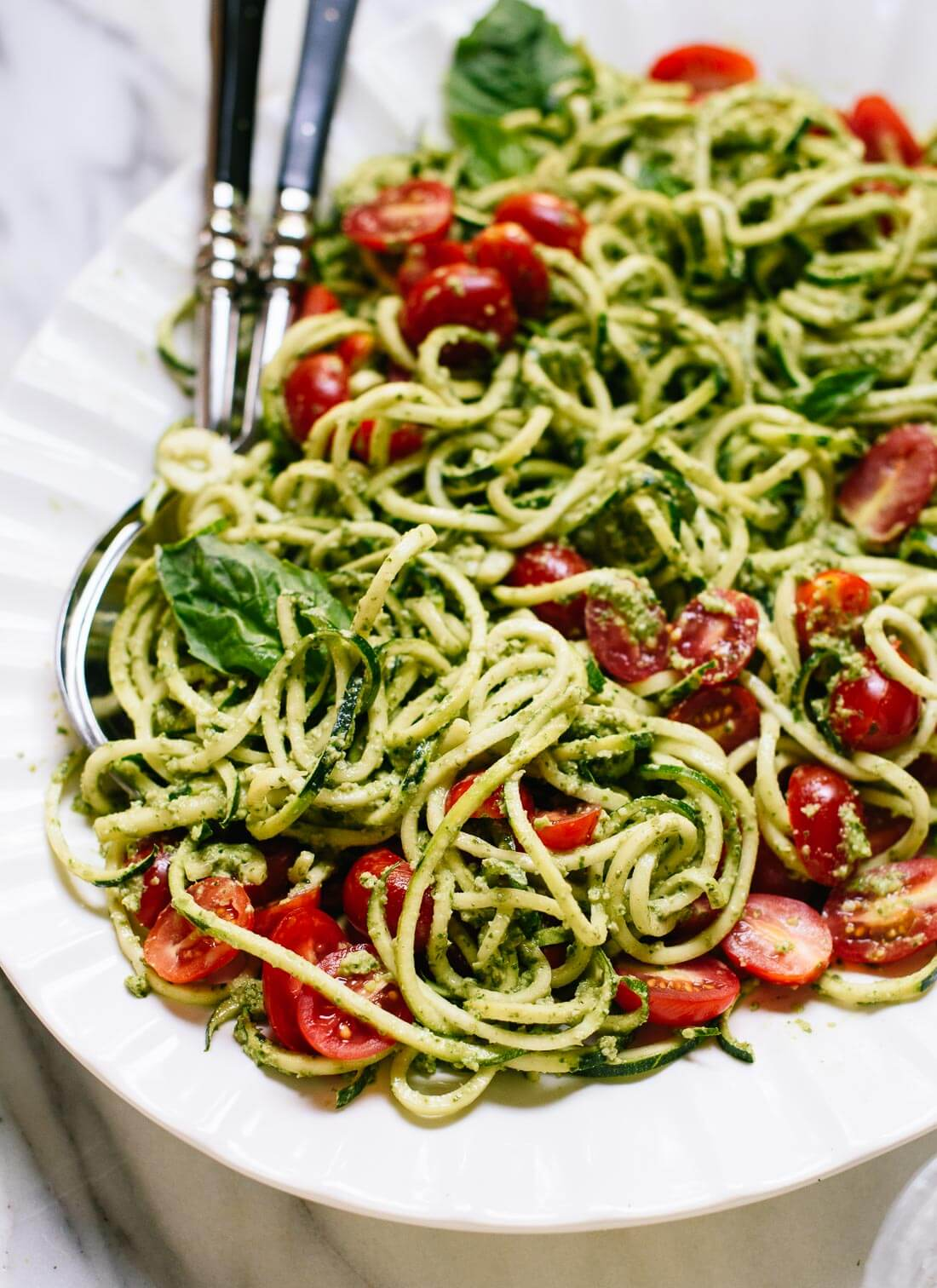 Healthy zucchini noodles with pesto and cherry tomatoes! cookieandkate.com