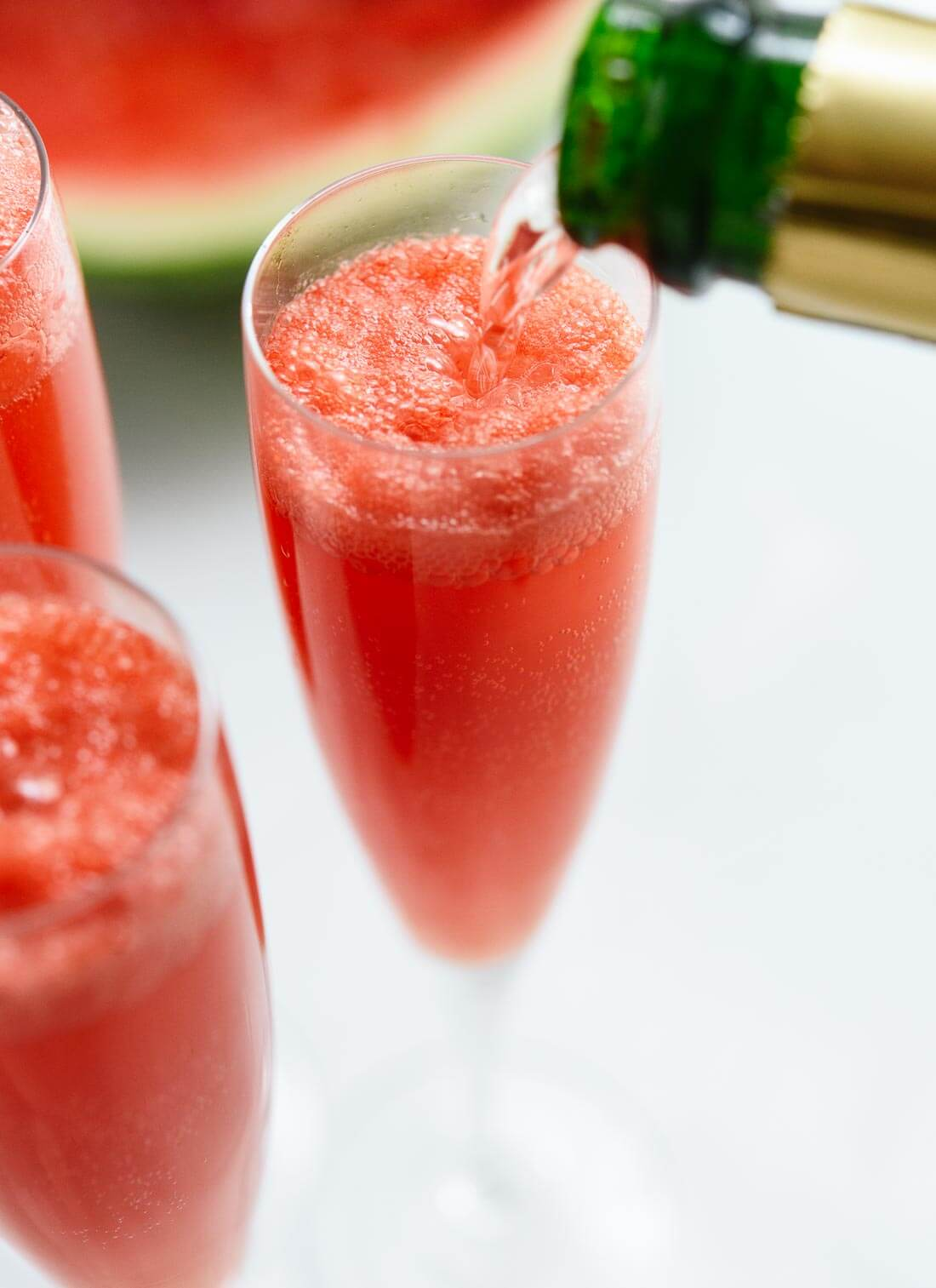 Learn how to make watermelon mimosas, so easy! cookieandkate.com