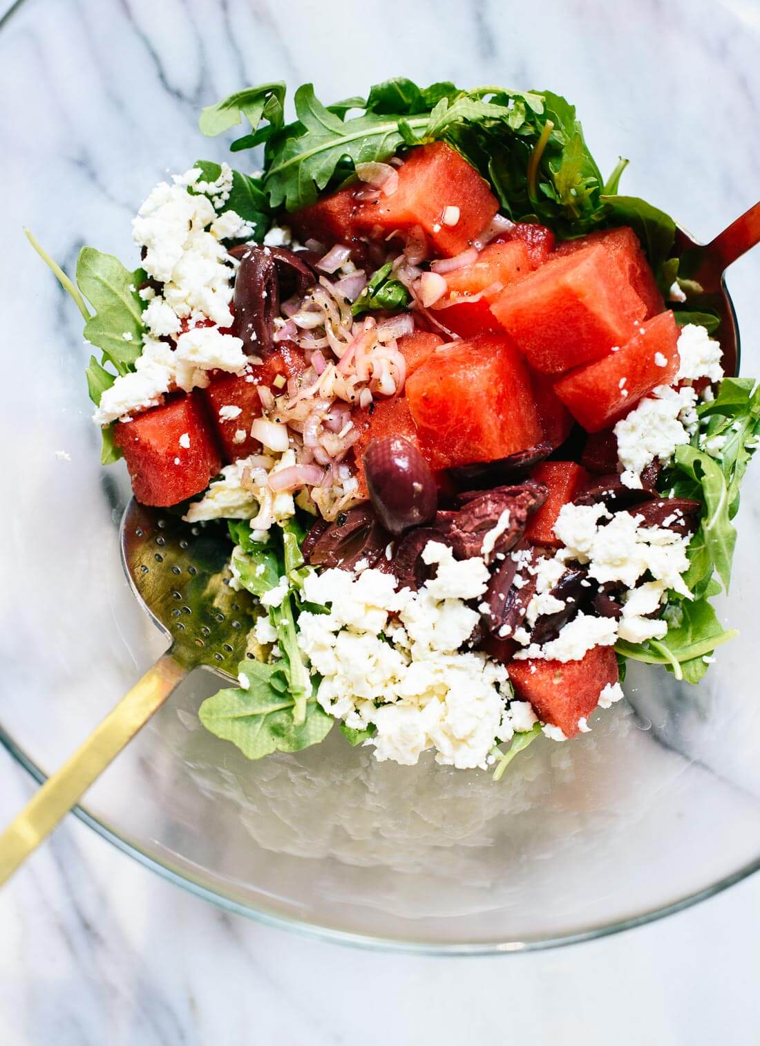 This surprising watermelon salad with greens is a perfect late summer salad! cookieandkate.com