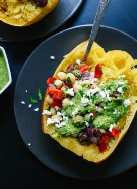 This healthy spaghetti squash recipe features your favorite Mediterranean ingredients, including pesto! It's a great fall dinner. cookieandkate.com