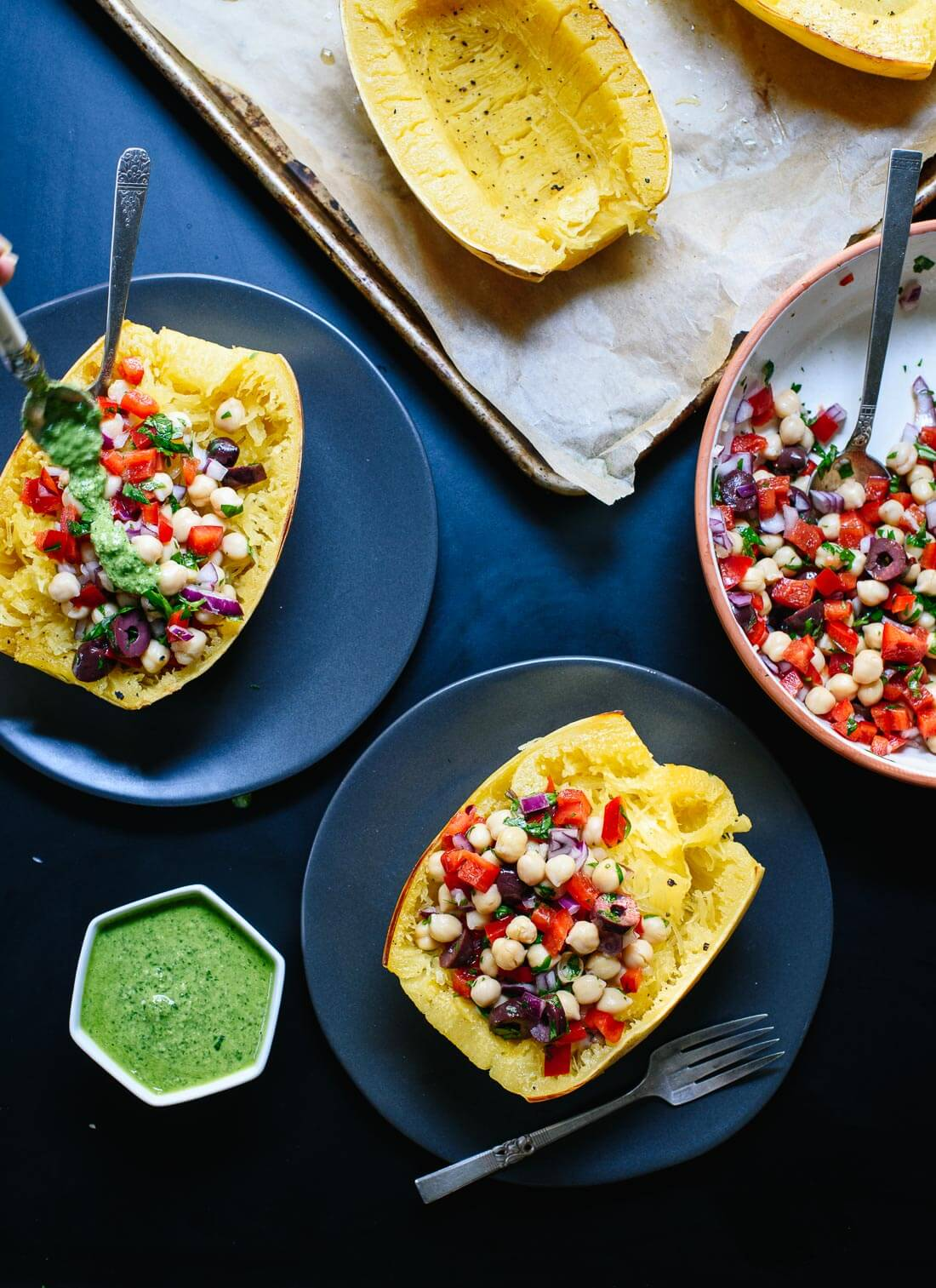 Mediterranean spaghetti squash bowls topped with pesto! So fresh and delicious. cookieandkate.com