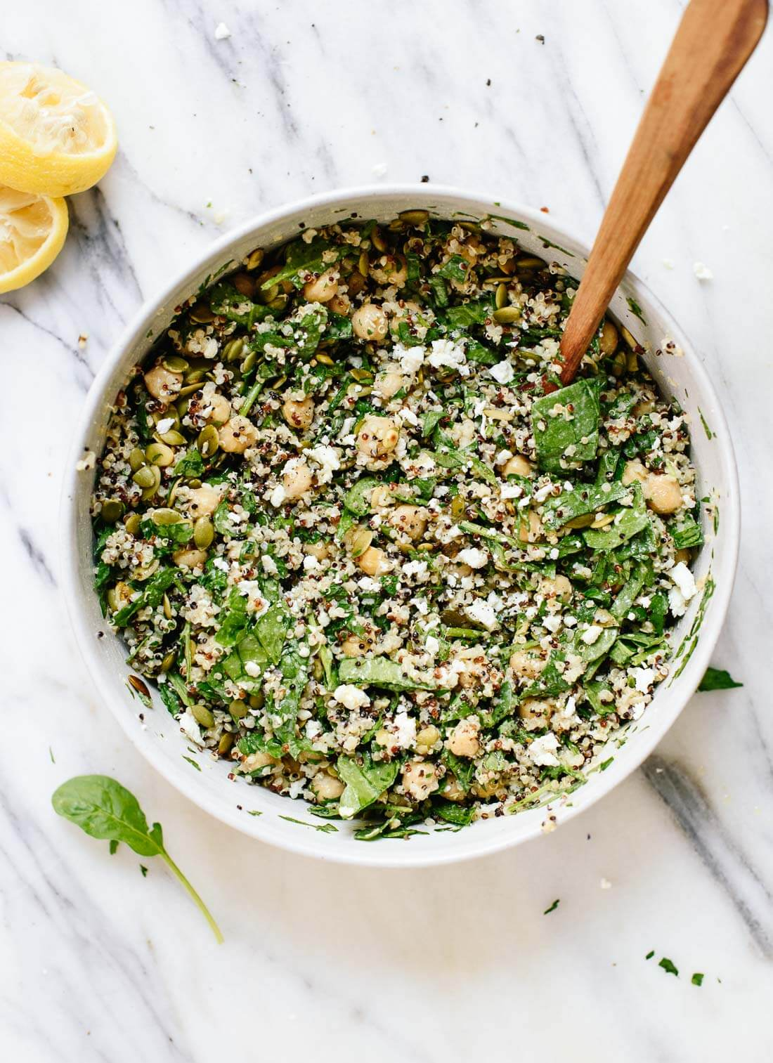 Healthy, hearty chickpea quinoa salad with lots of herbs and a delicious lemon-tahini dressing - cookieandkate.com