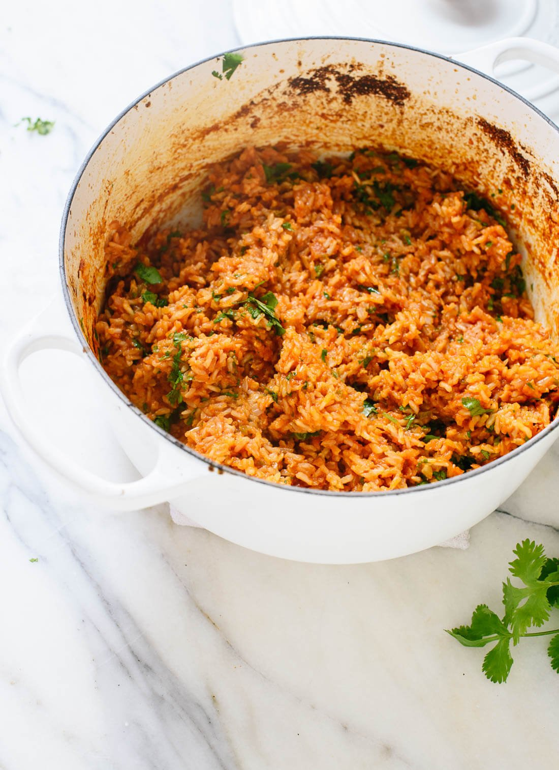 Delicious Spanish brown rice recipe - it's easy to make, just bake it all in the oven! cookieandkate.com