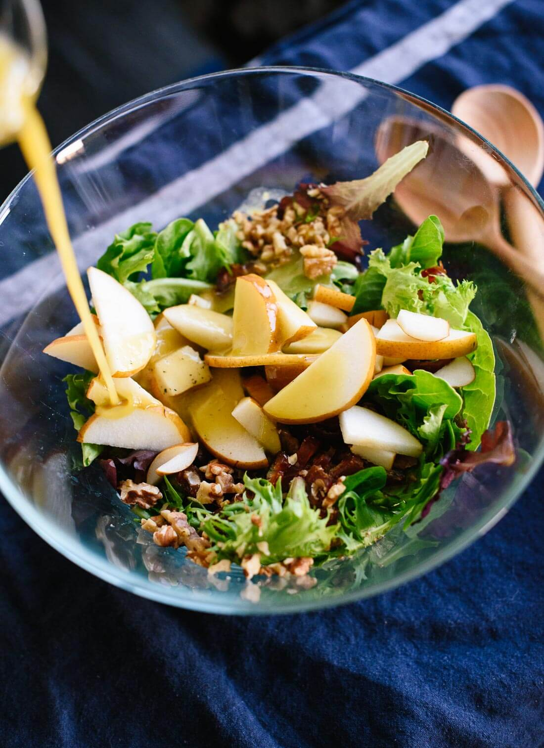 Here's a fresh green salad for your holiday table, featuring pears, walnuts, dates and blue cheese tossed in a simple vinaigrette! cookieandkate.com
