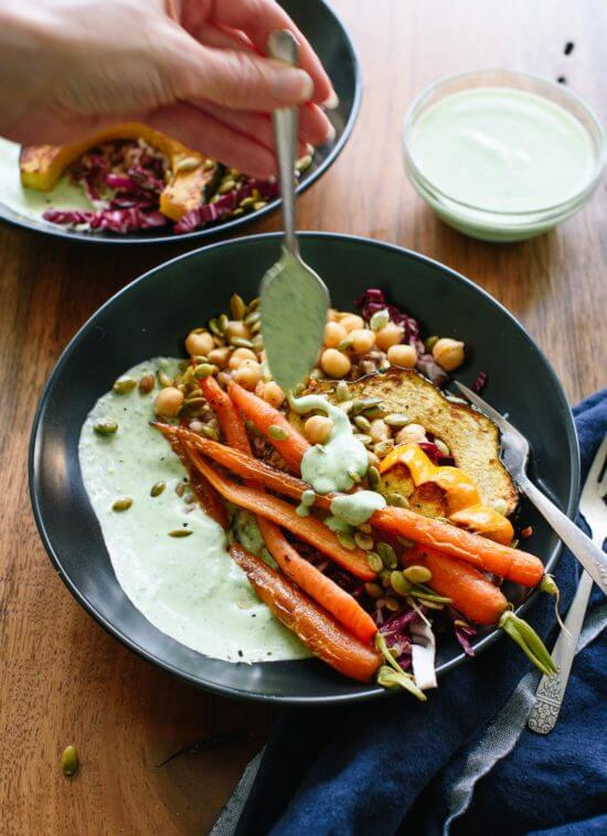 Green goddess yogurt sauce on roasted veggies and whole grains