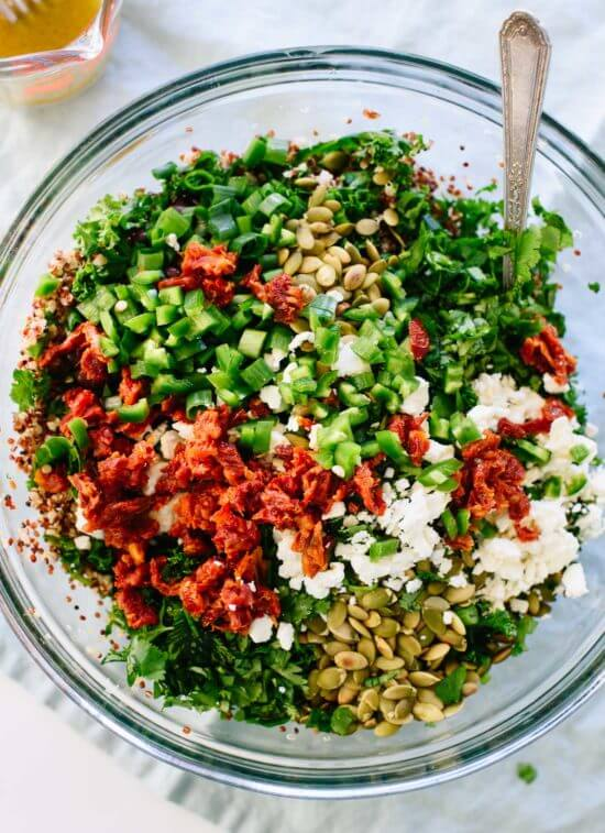 Mexican quinoa and kale salad with pepitas, black beans, sun-dried tomatoes and a cumin-lime dressing. cookieandkate.com
