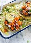 These delicious sweet potato tostadas make a great meatless dinner! Vegetarian, gluten free, and easily vegan.
