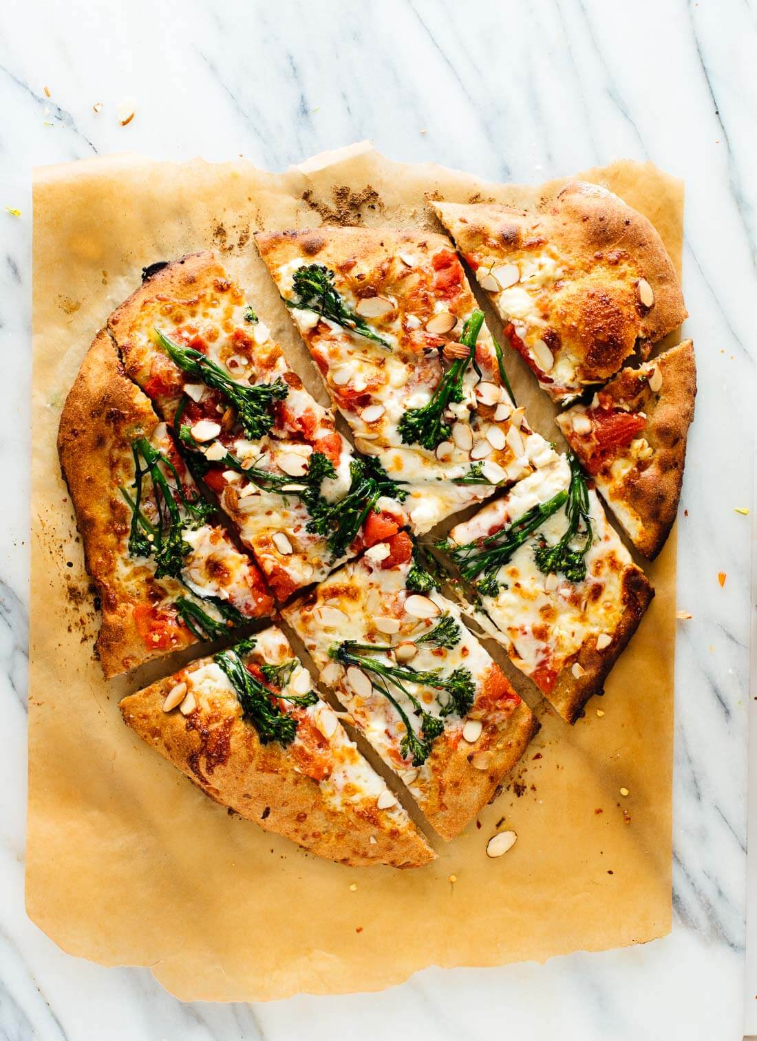 Amazing homemade broccolini pizza! It's my new favorite veggie pizza. Get the recipe at cookieandkate.com