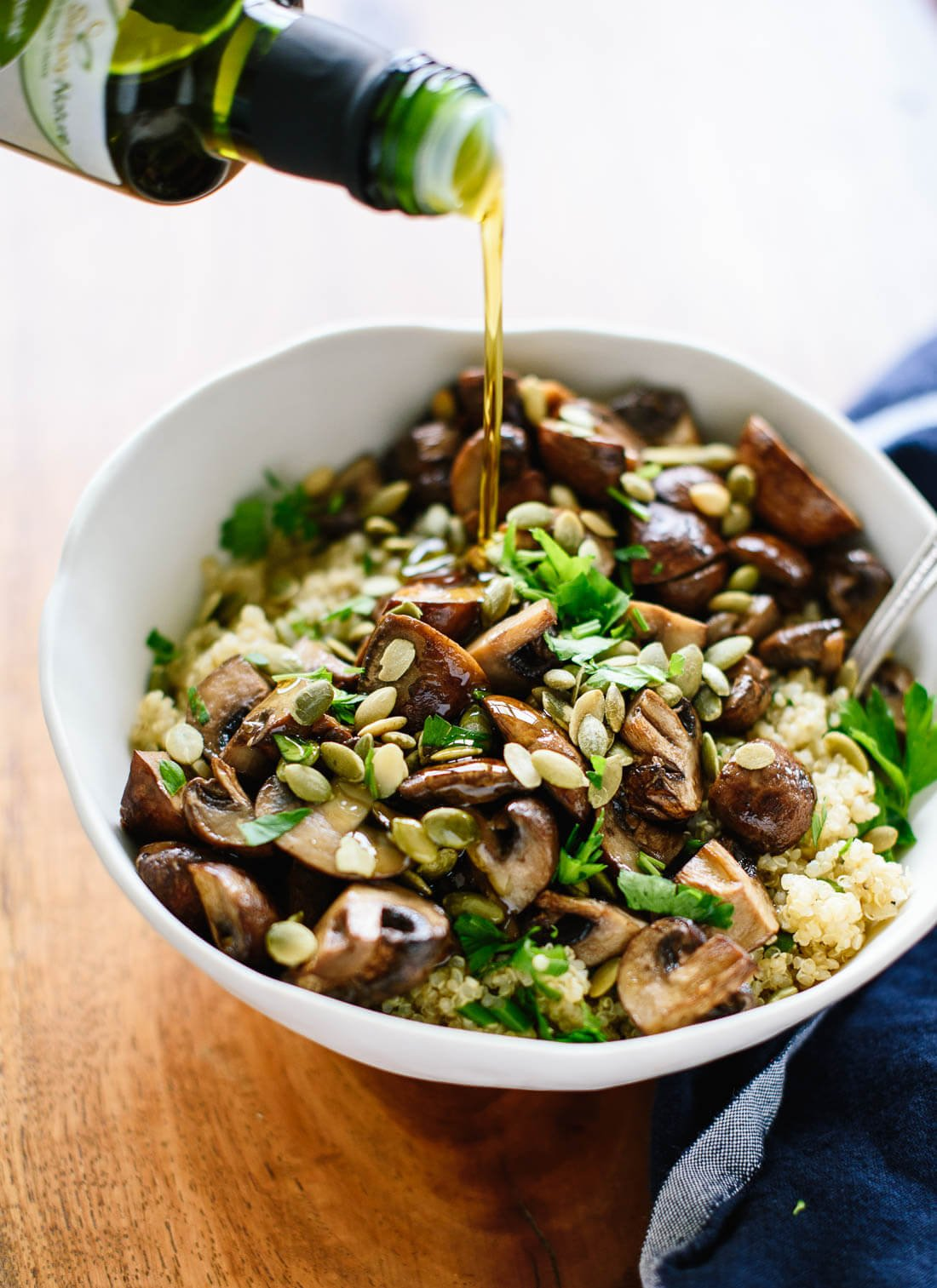 Roasted mushrooms on herbed quinoa with olive oil and pepitas