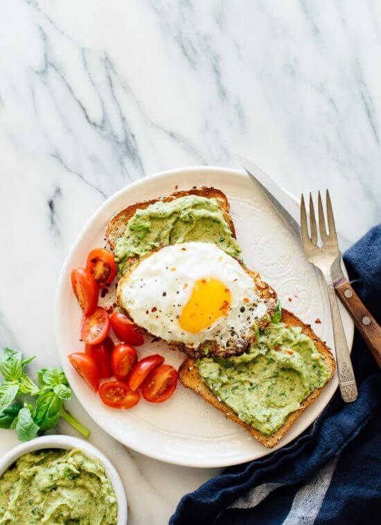 This avocado pesto toast recipe is fantastic with or without eggs! cookieandkate.com