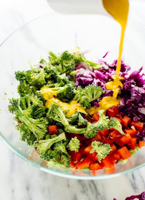 Healthy green salad recipe featuring chopped broccoli, bell pepper and cabbage in a zingy carrot-ginger dressing!