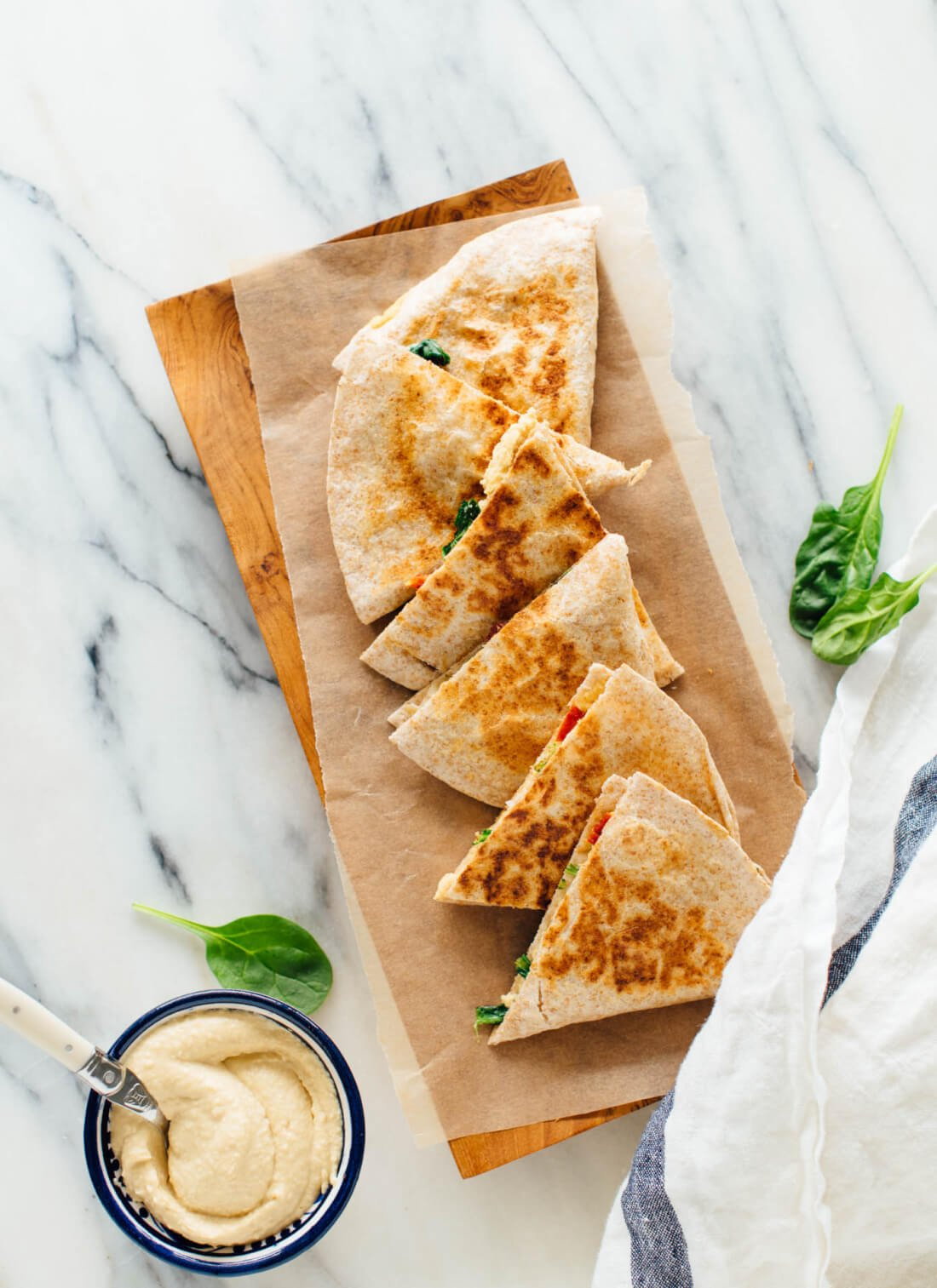 These quesadillas are made with hummus instead of cheese, and they are absolutely delicious! These hummus quesadillas are a healthy, dairy-free and vegan snack or meal. cookieandkate.com