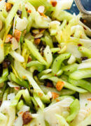 This celery salad recipe will surprise you! Crisp celery, toasted almonds, sweet dates and Parmesan combine to create a delicious, crisp, fresh salad. cookieandkate.com
