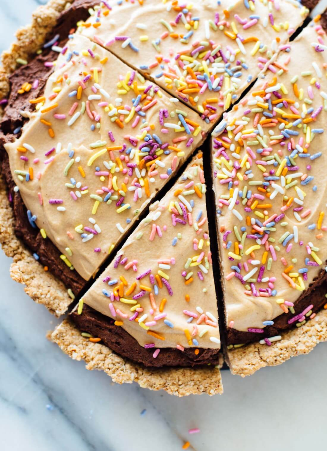 This chocolate peanut butter tart recipe is made with wholesome ingredients and tastes incredible! cookieandkate.com