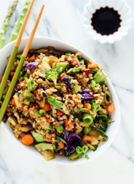 Vegetable fried rice made with extra veggies and brown rice, for health and flavor bonus points! Get the recipe at cookieandkate.com