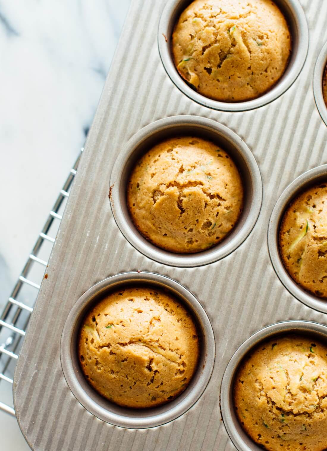 DELICIOUS whole-grain, naturally-sweetened zucchini muffins - cookieandkate.com