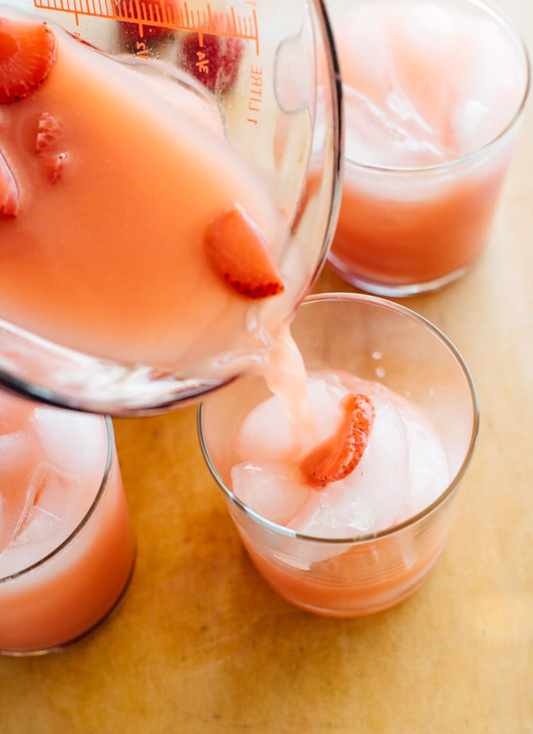 Pouring pink drink into glass