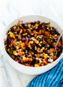 Perfect for parties and busy weeks! This fresh black bean salad recipe is as delicious as it is colorful. It's also vegan and gluten free. cookieandkate.com