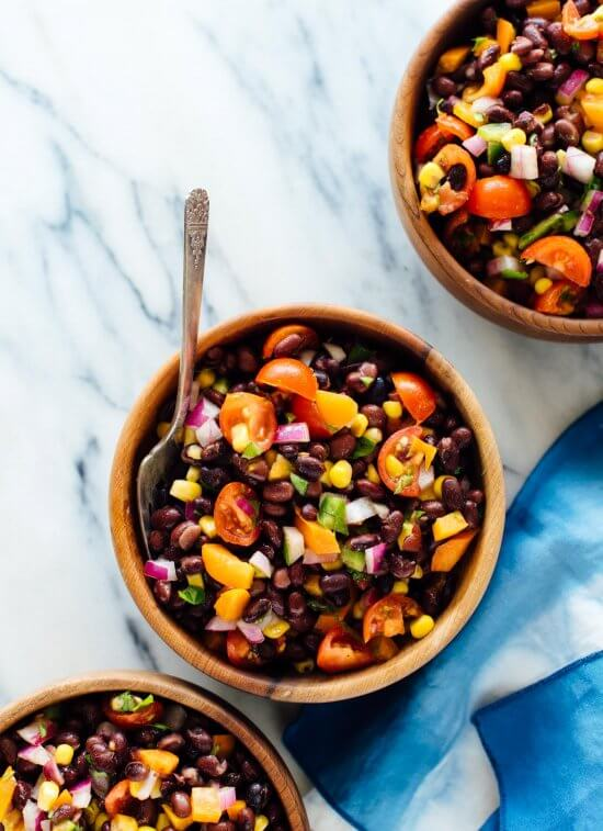 This fresh black bean salad recipe packs great for lunch! It's also perfect for parties and potlucks. Get the recipe at cookieandkate.com