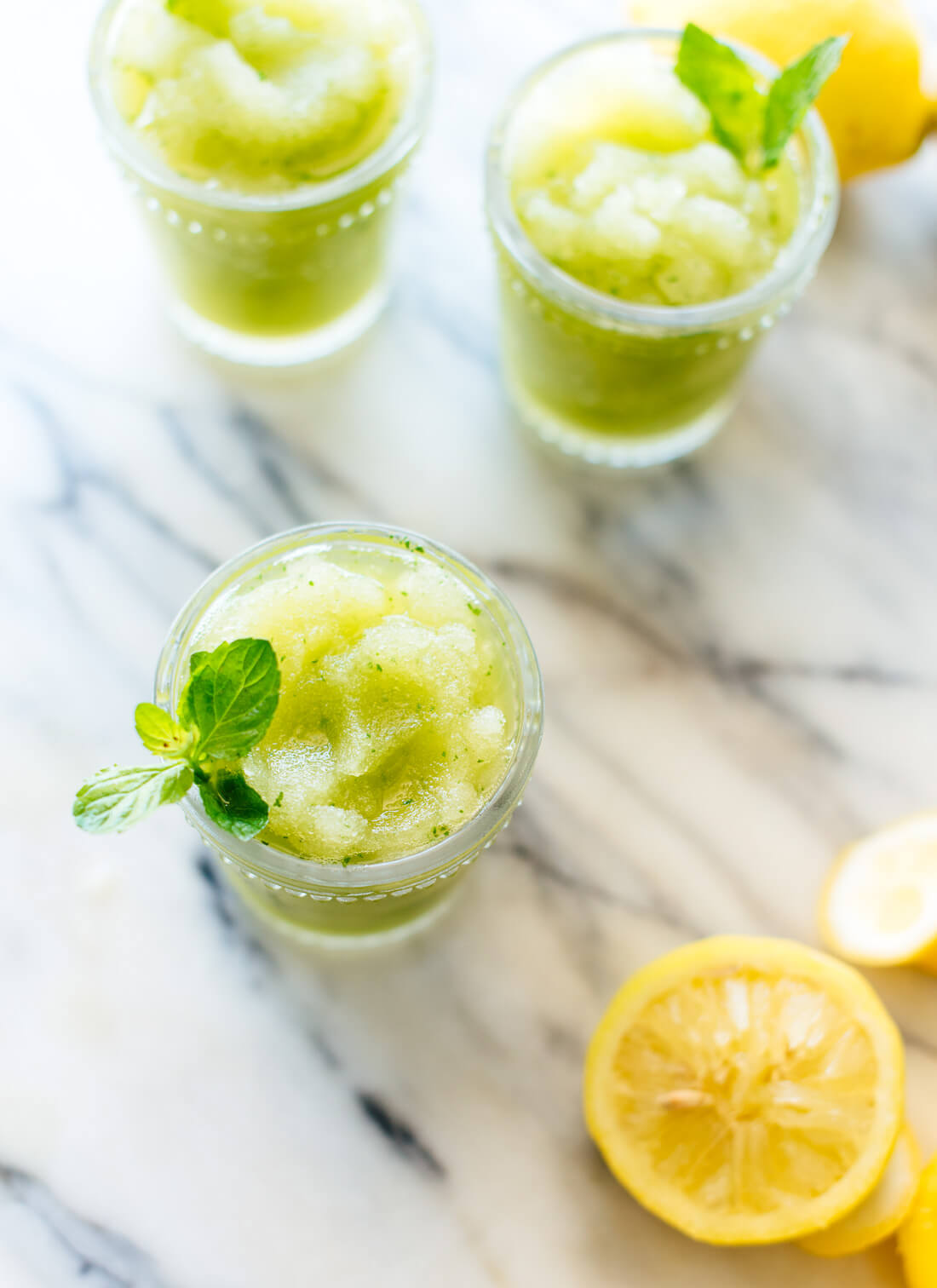 This frozen mint lemonade recipe is super refreshing and easy to make! cookieandkate.com