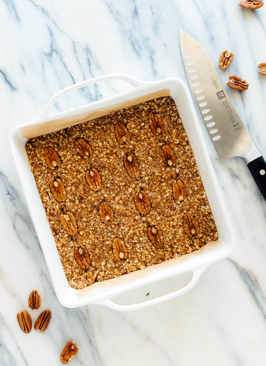 This pecan granola bars recipe is hearty and delicious! Enjoy these granola bars for breakfast or as a snack. Vegan and gluten free. cookieandkate.com
