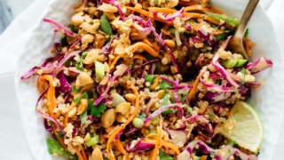 You're going to love this colorful, crunchy Thai peanut quinoa salad! It's made with carrots, cabbage, snow peas, and quinoa, tossed in a delicious peanut sauce. It packs great for lunch. Vegan and gluten free. cookieandkate.com