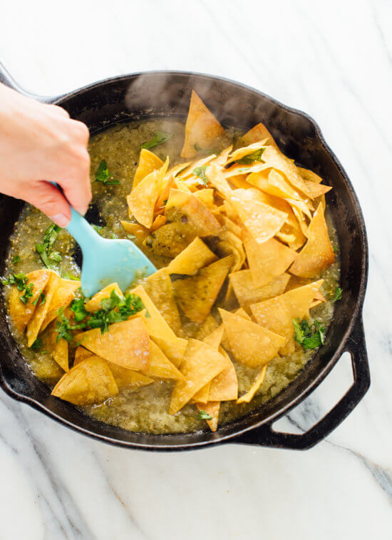 How to make chilaquiles verdes (tortilla chips tossed in warmed salsa verde, often served with fried eggs on top) - cookieandkate.com