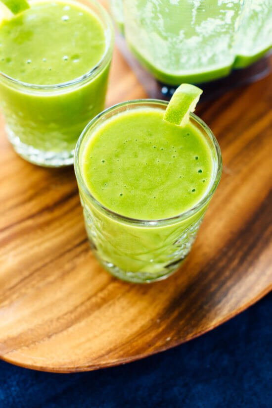 This mango green smoothie recipe tastes like a treat! Your whole family will love it. cookieandkate.com