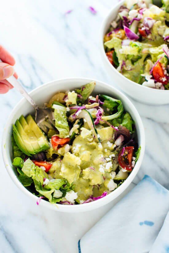 This delicious Mexican green salad with jalapeño-cilantro dressing is super fresh and mega nutritious! Vegetarian (easily vegan) and gluten free. cookieandkate.com