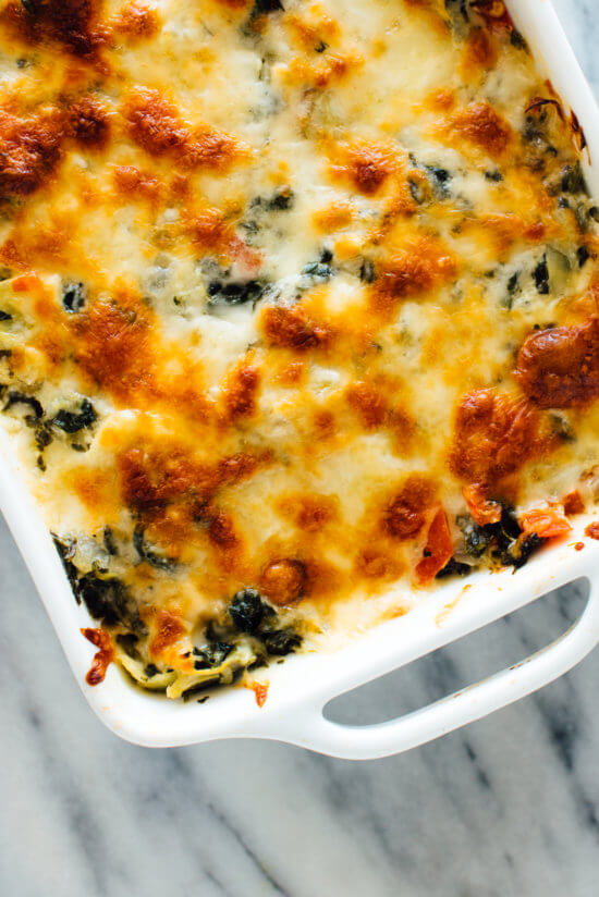 This cheesy baked spinach artichoke dip recipe is the perfect appetizer for parties and game day!