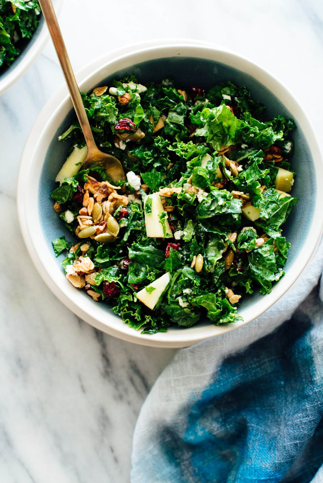 You're going to love this kale and apple salad with goat cheese, dried cranberries, and granola croutons!